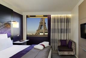 Chambre Privilège lit double vue Tour Eiffel - étages supérieurs